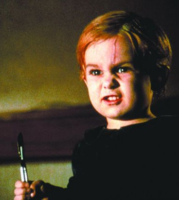 Gage from Pet Cemetery. Best use of a kid to scare the crap out if you.