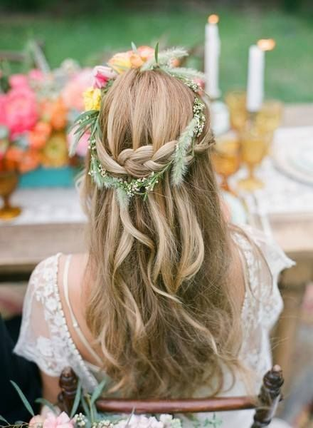 This bohemian bride's hairstyle has it all! Loose tousled waves, braids, and topped off with a #flowercrown {Fiore Beauty}