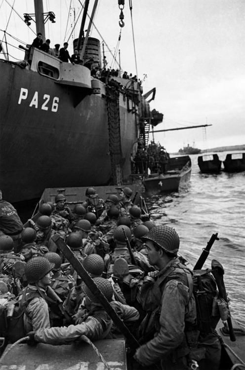 Allied troops in landing craft boarding ships on their way to the beach landings of Normandy on the eve of D-Day in the harbor of Weymouth, England - 5 June 1944