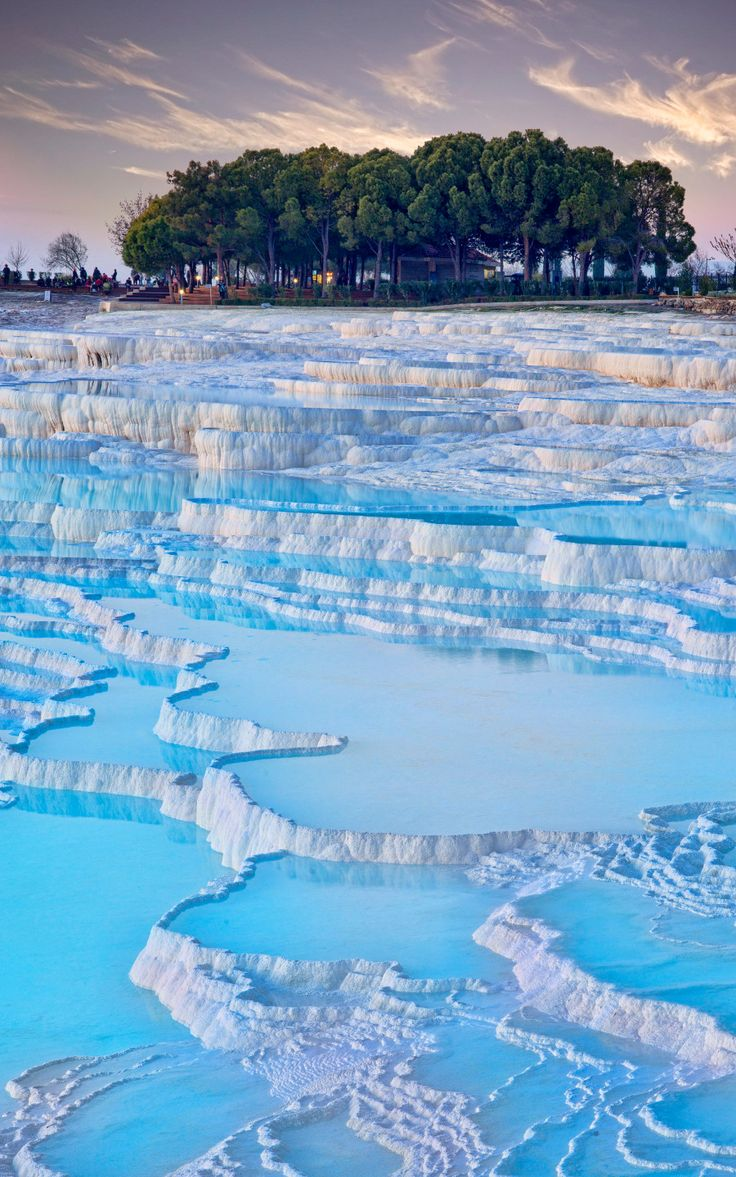 The striking rock pools of Pamukkale were formed by calcium deposits flowing from the natural hot springs at the top of the small mountain. The resulting travertine pools are a beautiful sight.