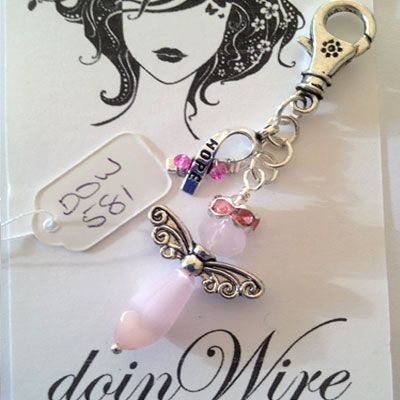 doinWire handcrafted craft wire Clip-On dangler Angel with pink halo, pink Cat-Eye teardrop Crystal and Awareness Charm wrapped with bright pink crystals on chain. DOW581