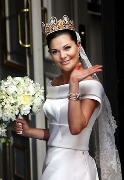 Crown Princess Victoria wore an ivory silk, off-the-shoulder gown custom-designed for her by Sweden's own Pär Engsheden.