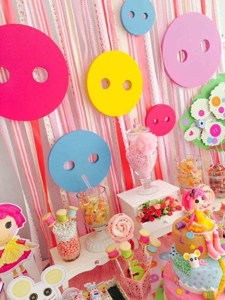 Fun button backdrop at a LaLaloopsy birthday party! See more party ideas at CatchMyParty.com!