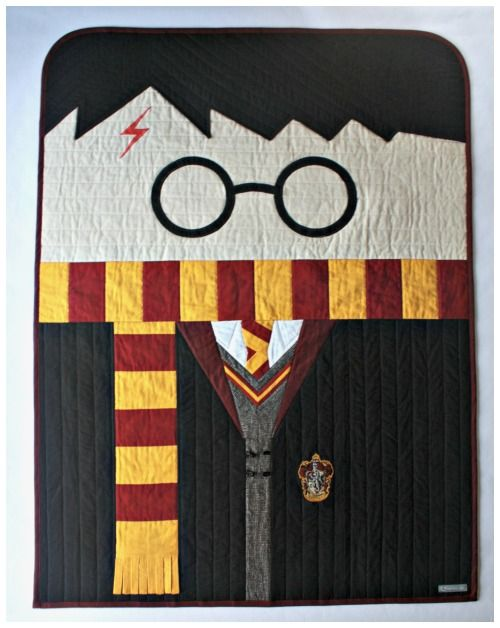 A Harry Potter shaped quilt.                              …