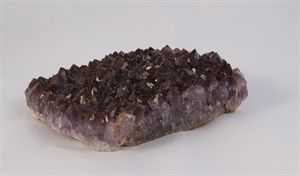 A solid chunk of red and purple amethyst.  Found on the shore of Lake Superior, It's a real stunning piece.  Measures 5 inches wide, 4.5 inches deep and 1 inch high.