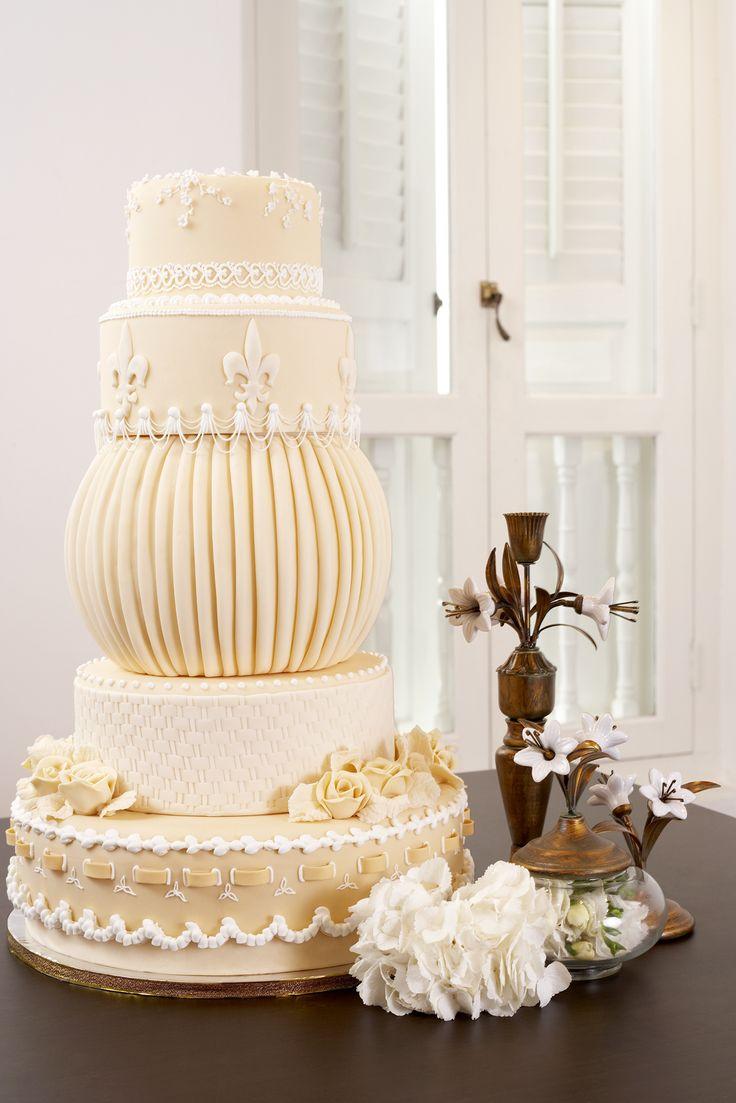 cream fleur de lis wedding cake