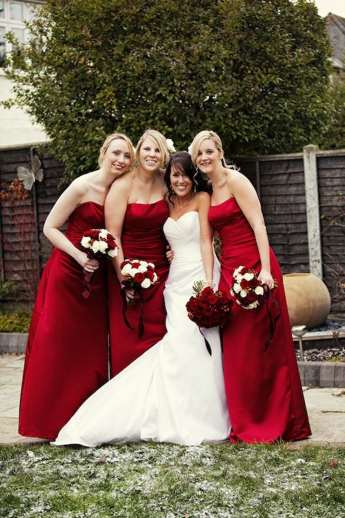 Bride + bridesmaids. I LOVE that rich red :)