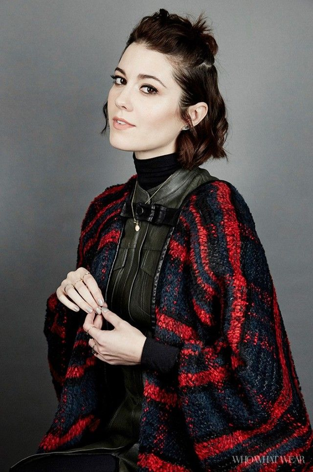 Mary Elizabeth Winstead wears a leather dress, turtleneck, and a cape