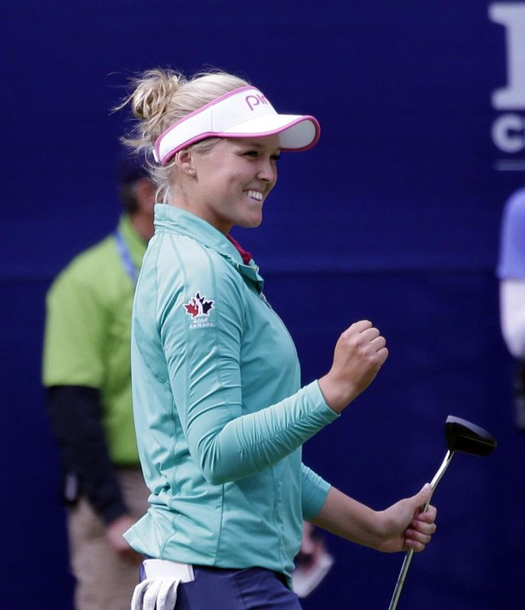 Brooke Henderson, of Canada, reacts to making a birdie on the 17th hole in the final round at the Women's PGA Championship golf tournament at Sahalee Country Club Sunday, June 12, 2016, in Sammamish, Wash. (AP Photo/Elaine Thompson)