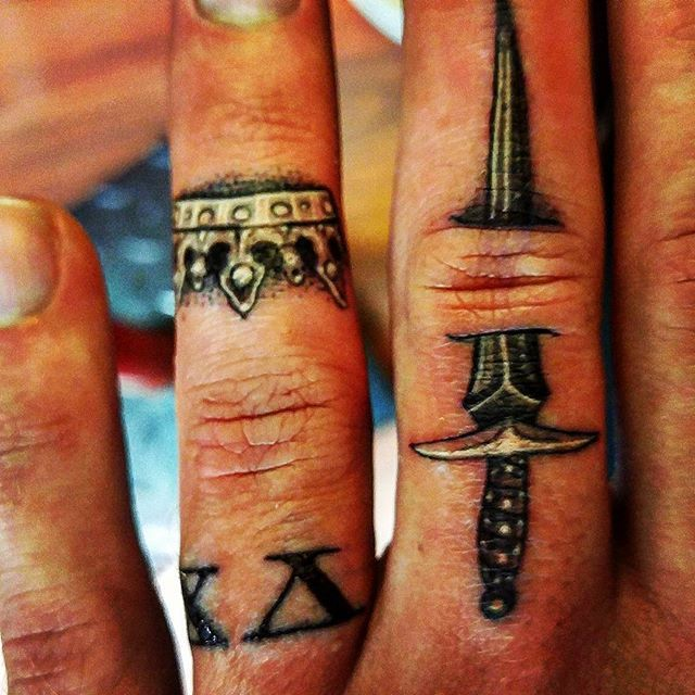 Got my wedding ring tattoo done tonight, kings crown and sword so im always ready to defend my queen  #freshink #ringtattoo #wedding #weddingring #king #queen #fiance #wife #blackandgrey #blackandgreytattoo #blasted #fingertattoo