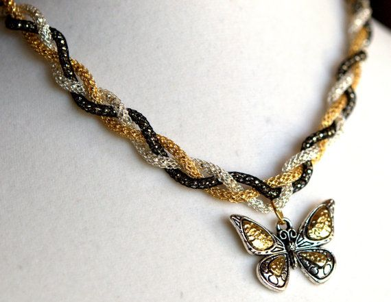 Jewelry/pendant/choker of braided silver silk chain with metalwork butterfly pendant in gold and silver.
