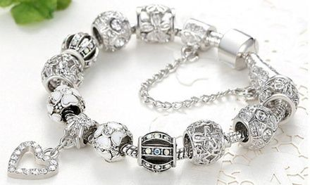 18K White Gold Plated Crystal Heart Charm Bracelet Made with Swarovski Elements Was: $44.49 Now: $12.99.