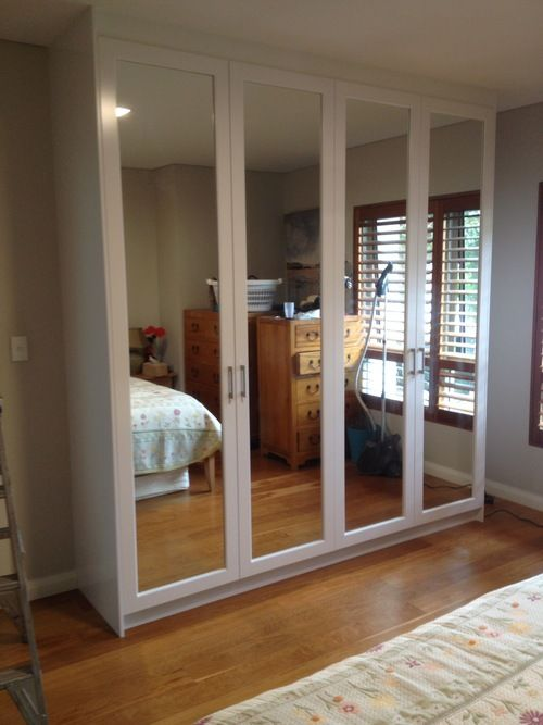 polyurethane hinged doors wardrobe with mirror inserts.JPG