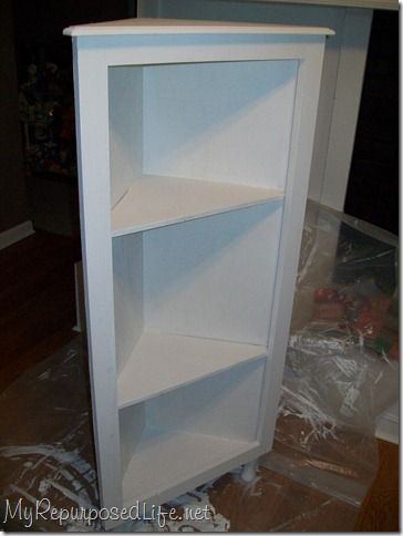 DIY corner cabinet--this would be handy and doesn't look too incredibly difficult.