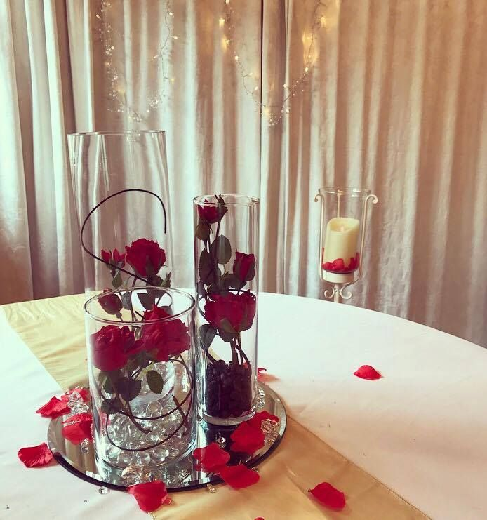 Trio of vases with red roses with a Beauty & The Beast theme for your wedding or event.  Inspired by the new Disney film.  Available to hire in the Midlands area.  Please look at our website for further details of products available to hire x