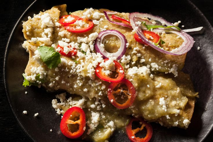 An easy chicken enchiladas verdes recipe. You will need tomatillo sauce, cooked chicken, corn tortillas, and Mexican crema for this recipe.