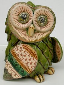 Green Owl Entirely handmade, modeled, caged, etched and coloured with ceramic Varnishes on Effects and ceramic Varnishes. It was created following the ancient Technics of the traditional Ceramic from Grottaglie and enriched with new ornamental Expressions. #madeinitaly #artigianato #oggettistica #craftobject #ceramica #ceramic