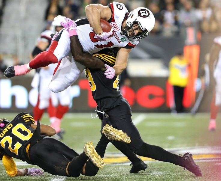 Week 17:Ottawa Redblacks' Patrick Lavoie (81) is tackled by Hamilton Tiger-Cats linebacker Larry Dean (49) during the first-half of CFL football action in Hamilton on Friday, October 14, 2016. THE CANADIAN PRESS/Peter REDBLACKS at Tiger-Cats - CFL.ca