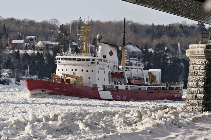 Canadian Coast Guard ice breaker Pierre-Radisson clears the ice flow under the Quebec bridge on the St-Lawrence River in front of Quebec Cit...