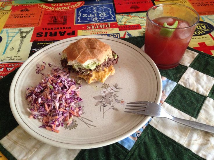 Cheeseburger with homemade guacamole, homemade red cabbage and carrot salad and a ceasar. Life is good!