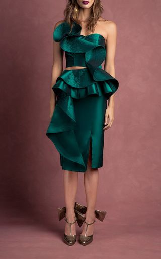 This **Johanna Ortiz** skirt features a pencil shape and a cascading peplum ruffle.