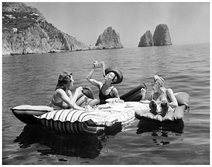 Ladies having spaghetti and wine while they float in the Isle of Capri - 1939, H. Wright