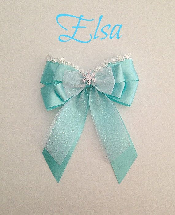 This listing is for 1 - Disney inspired Frozen Elsa princess hair bow. It is handmade by me. The bow is made with satin ribbon. It measures
