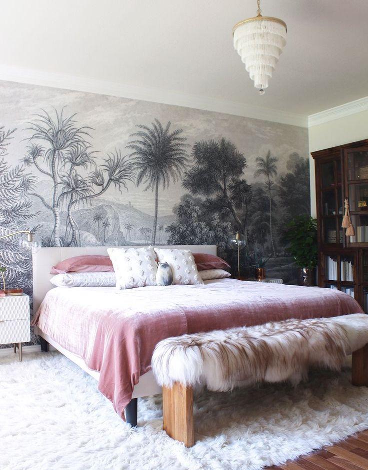 neutral bed tones // chandelier //  wallpaper