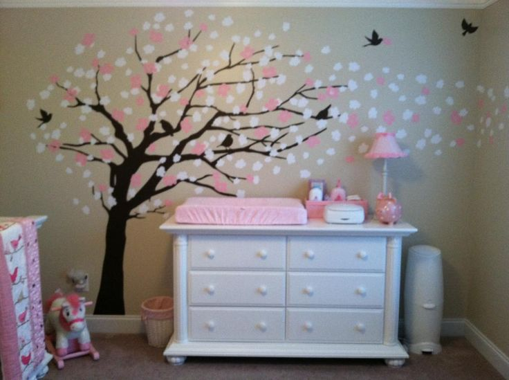 Baby Girl Nursery. Babysrus - Baby Dresser white.  tree, birds, flowers, rocking horse, changer on dresser. beautiful pink, tan walls.