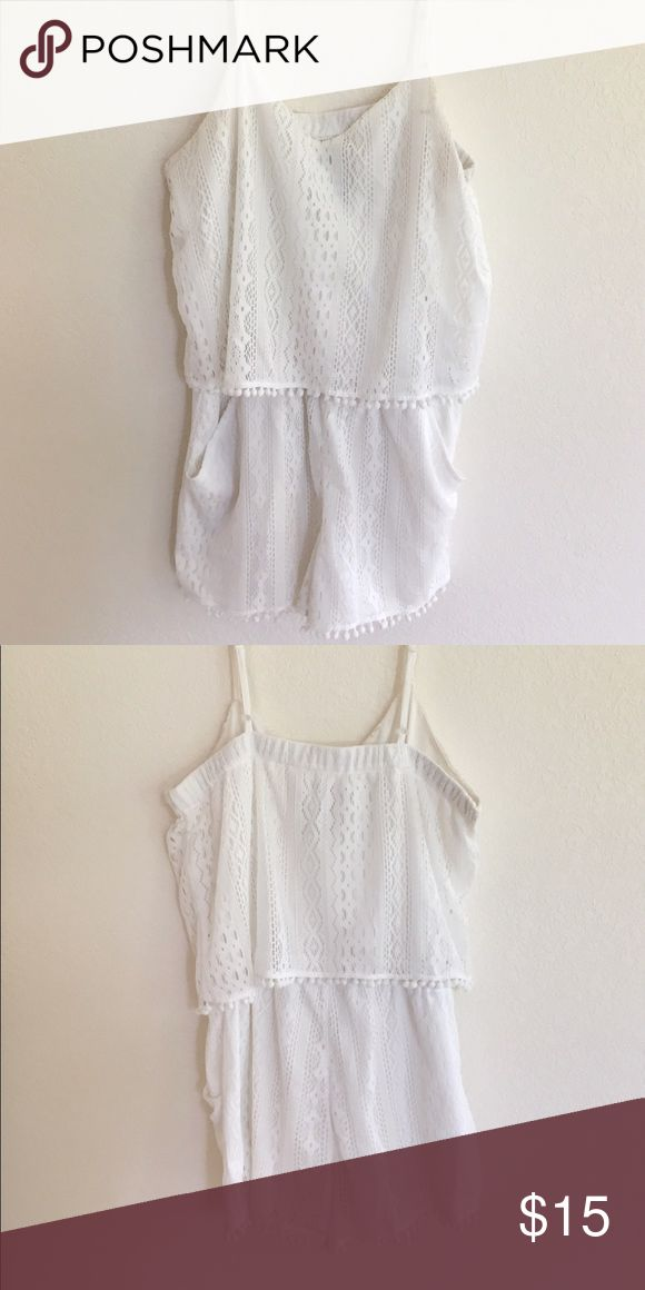 White lace romper with little Pom poms Adorable white lace romper. Romper has pockets and is super comfortable. The waistband is stretchy for added comfort and also the back is stretchy so it's not super tight on your back. I love the Pom Pom detailing this romper has. Is in great condition but a few of the Pom poms have fallen off but not noticeable at all! Has adjustable straps and the color is perfect. Makes your skin color look amazing and is flattering to the body. Pair with some…