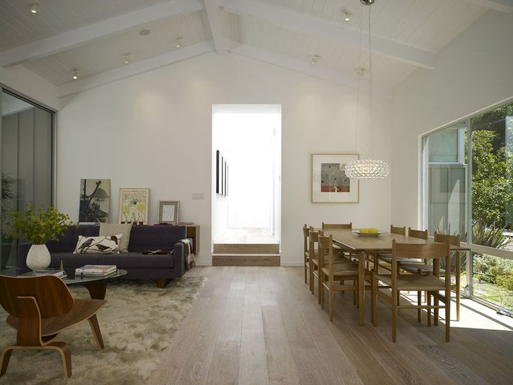 VAULTED CEILING- White oak flooring in living room of Los Angeles renovation by Montalba Architects.