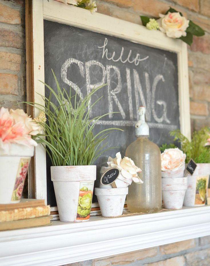 Vintage Farmhouse Spring Mantel with faux flowers and painted terra-cotta pots