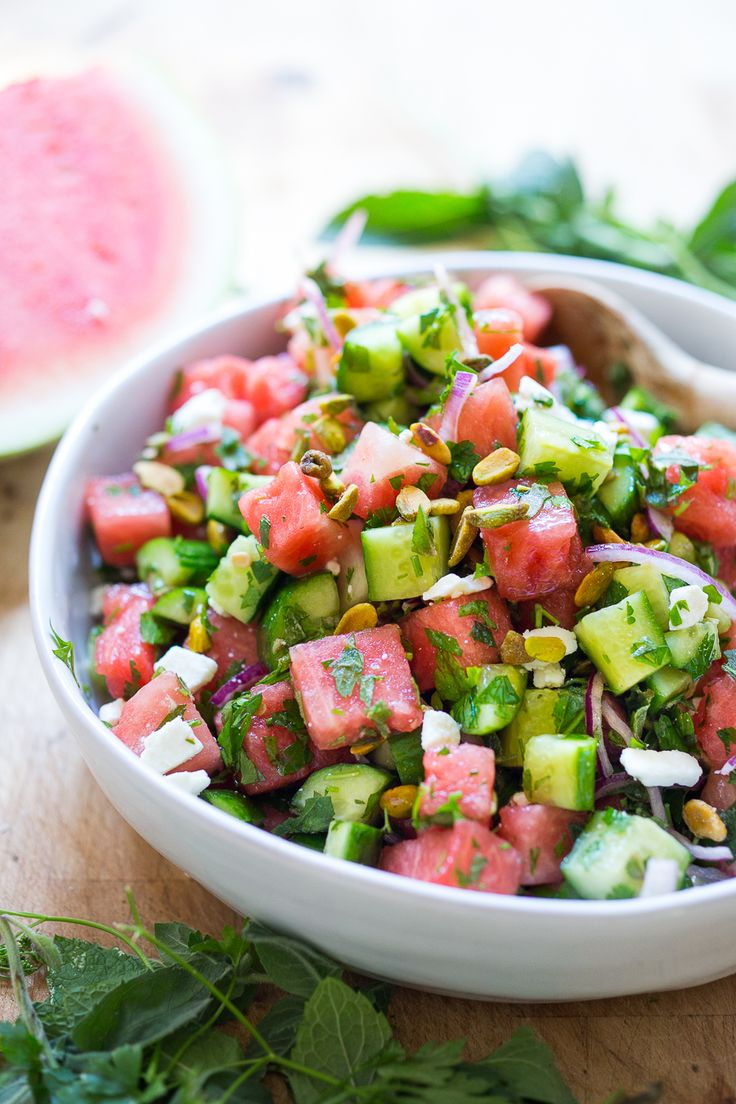Moroccan Watermelon Cucumber Salad with parsley, mint, red onion, pistachios and crumbled feta (optional)- and a hint of clove. Refreshing, quick & tasty!