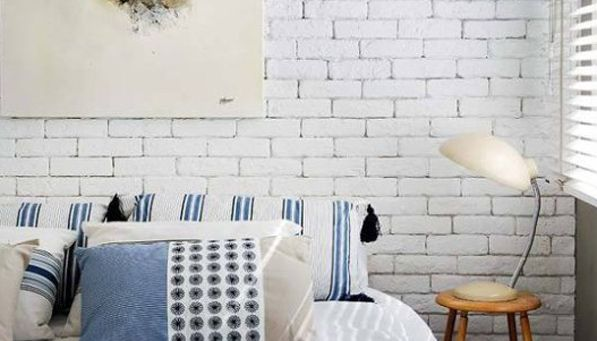 """The key to fake brick wallpaper is to find one that's neither too """"new looking"""" nor too distressed."""