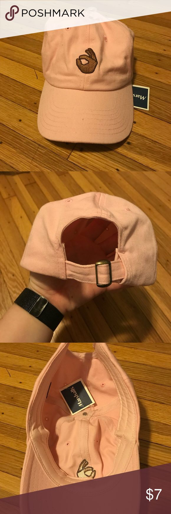 Emoji Hat NWT. This hat is pink with a hand emoji on it. The back is adjustable to size. Accessories Hats