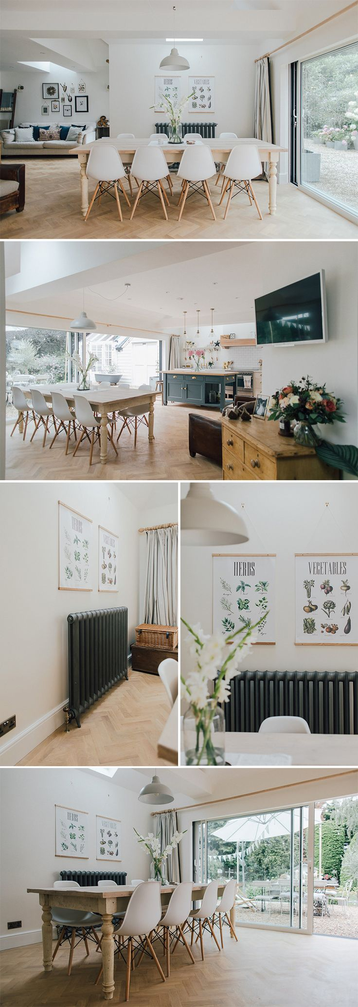 a modern country kitchen with parquet flooring and bi fold doors | rubble radiator | Dining room wall art | radiator painted in downpipes | 8 Seater Wooden Table Made From Reclaimed Scaffold Boards | Eames Replica Eiffel Chairs | large dining table | Kitchen island inspiration