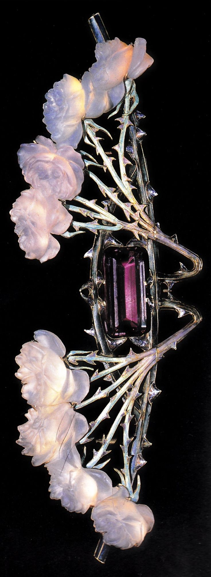 An Art Nouveau 'Rose Stems' brooch-pectoral, by René Lalique, 1904-05. Gold, glass, enamel and amethyst. Source: Cartier, 1899-1949: The Journey of a Style.
