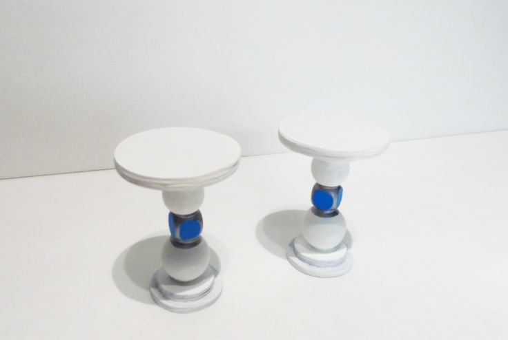 These are cute little side tables that can be put anywhere in your dollhouse.  Watch our  video on you tube under chloe's dollhouse things channel.