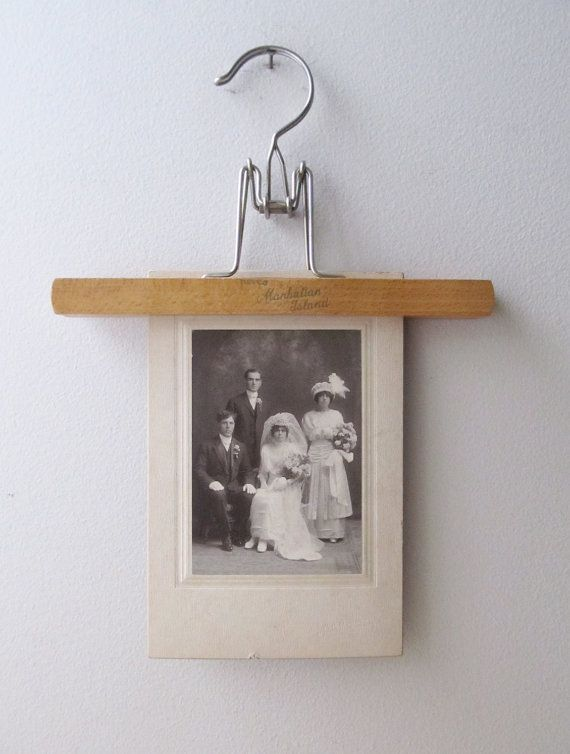 Here is a vintage wooden hanger photo display. Look great, but keep mind that this and other hangers or clips could leave indentations in photos.