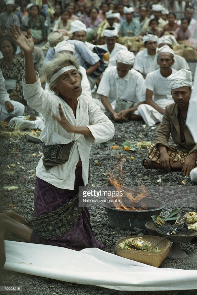 Swaying and chanting, a woman implores gods to expel demons, Besakih, Bali, Lesser Sunda Islands, Indonesia