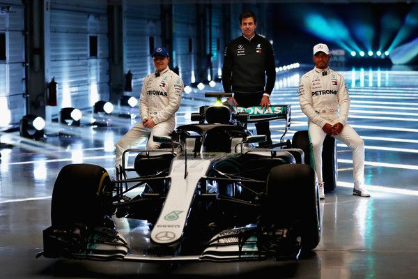 Lewis Hamilton Photos - (l-r) Valtteri Bottas of Finland and Mercedes GP, Mercedes GP Executive Director Toto Wolff and Lewis Hamilton of Great Britain and Mercedes GP pose for a photo with the Mercedes W09 during the launch of the Mercedes Formula One team's 2018 car, the W09, at Silverstone Circuit on February 22, 2018 in Northampton, England. - Lewis Hamilton Photos - 13 of 30099