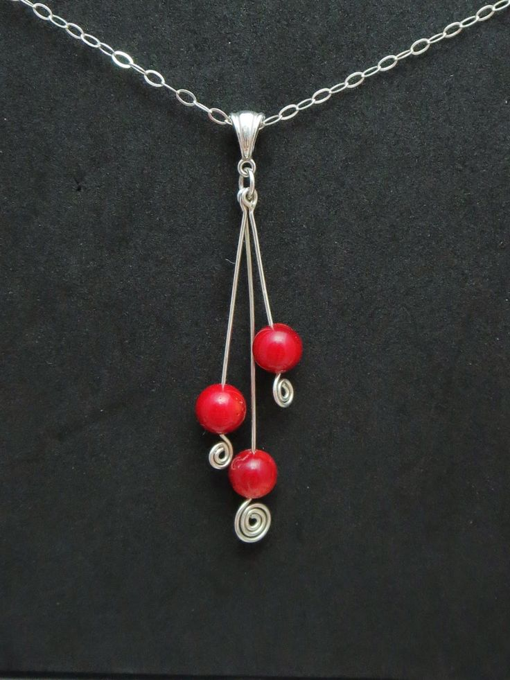 """""""Fiesta"""" - Sterling Silver & Red Coral."""