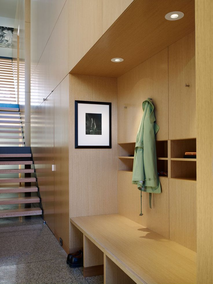 Entryway Design Ideas - 3 Different Styles Of Entryway Benches // This built-in storage/bench combo creates an organized entryway with shoe cubbies underneath and shelves in the middle for keeping important things together.