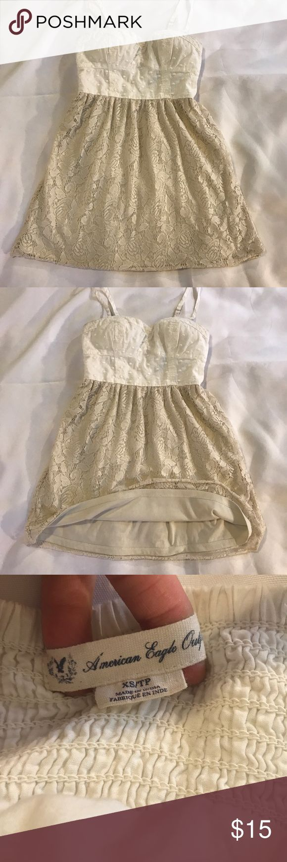 "American Eagle lace sundress American Eagle Outfitters beautiful cream lace spaghetti strap sundress in women's XS. Top to bottom length is 25"", lined skirt. In excellent used condition with no flaws! Clean and ready to ship. Check out my other listings for a bundle discount! American Eagle Outfitters Dresses Mini"