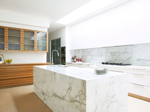 A modern kitchen but the use of timber and marble create a more classic look.