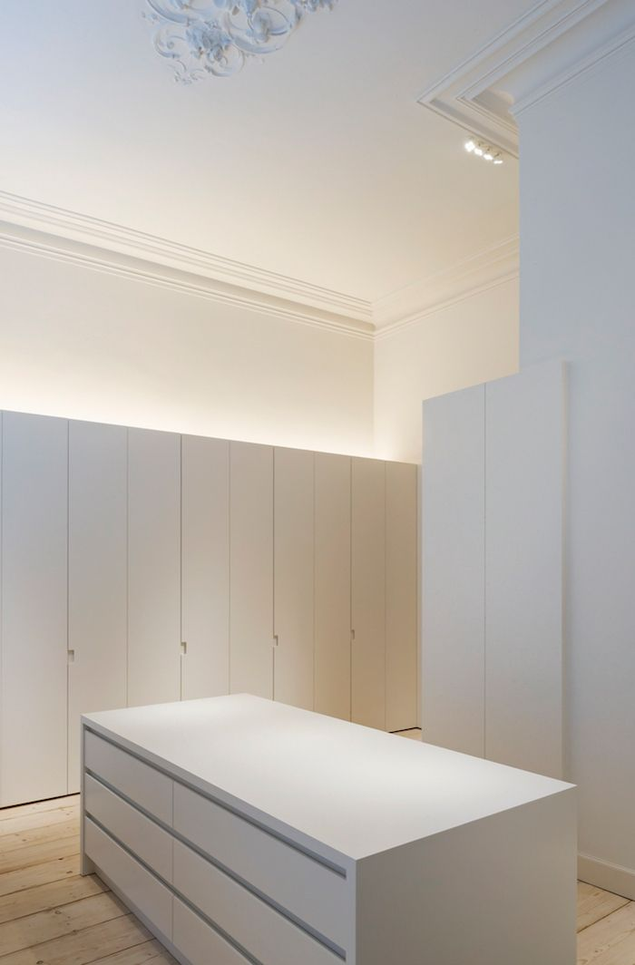 modern minimalist uplighting on top of cabinets; LED accent quad.