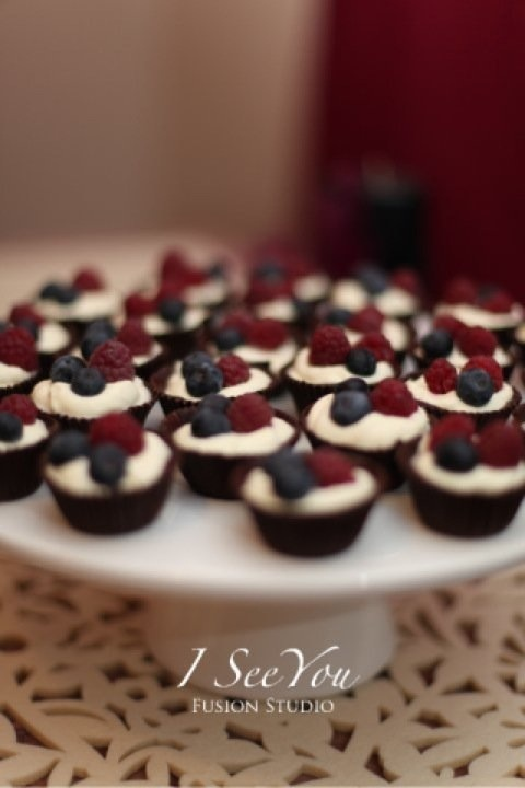 Chocolate cups with Cointreau infused cream topped with fresh berries