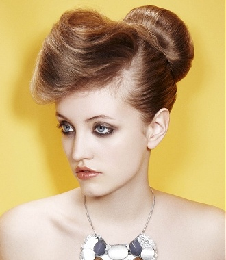 A long blonde straight updo top knot coloured OFFICE hairstyle by Guy Kremer