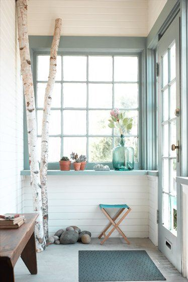 light-filled entryway with reclaimed wood bench, recycled glass vase, river rock, succulents in pots, and birch branches ... doesn't get much better?