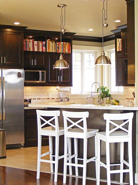 white subway tile with dark cabinets.